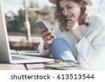pretty female traveler sitting... | Shutterstock . vector #613513544