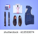 classic clothes on blue... | Shutterstock . vector #613533074