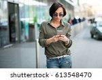woman walking phone   Shutterstock . vector #613548470