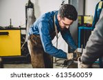 welder checking angle of welded ... | Shutterstock . vector #613560059