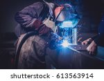 industrial welder with torch... | Shutterstock . vector #613563914