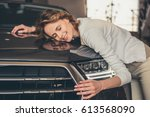 visiting car dealership.... | Shutterstock . vector #613568090