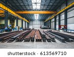 Industrial hall with cutting, welding machines and metal profiles - stock photo