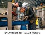 industrial welder with torch... | Shutterstock . vector #613570598