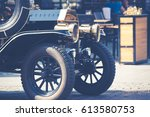 old fashioned car on the street ... | Shutterstock . vector #613580753