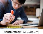 business man hand holding a... | Shutterstock . vector #613606274