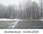 empty parking lot with snow... | Shutterstock . vector #613612034