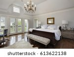 Small photo of Master bedroom in luxury home with doors to balcony.