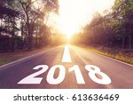 empty asphalt road and new year ... | Shutterstock . vector #613636469