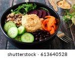 healthy salad bowl with hummus  ...   Shutterstock . vector #613640528