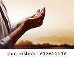 muslim man praying at sunset | Shutterstock . vector #613655516