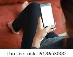 close up women use smart phone... | Shutterstock . vector #613658000