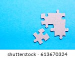 puzzle pieces with empty space... | Shutterstock . vector #613670324