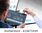 business colleagues working and ... | Shutterstock . vector #613671434
