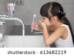 little asian cute girl brush... | Shutterstock . vector #613682219