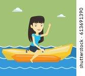 female tourists riding a banana ...   Shutterstock .eps vector #613691390