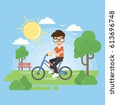 boy on bike in park. healthy... | Shutterstock .eps vector #613696748