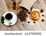 cup of coffee and pastry on... | Shutterstock . vector #613700900