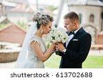 stylish wedding couple walking... | Shutterstock . vector #613702688