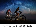Woman And Man Riding A Bicycle...