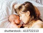mother with newborn baby... | Shutterstock . vector #613722113