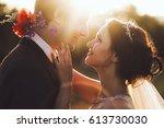 sunshine portrait of happy... | Shutterstock . vector #613730030