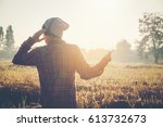 young hipster man listening to... | Shutterstock . vector #613732673