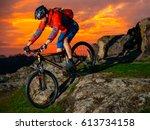 cyclist riding the mountain... | Shutterstock . vector #613734158