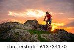 cyclist riding the mountain... | Shutterstock . vector #613734170