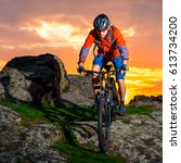 cyclist riding the mountain... | Shutterstock . vector #613734200