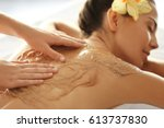 young woman receiving scrub... | Shutterstock . vector #613737830