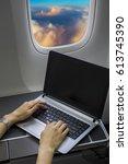 working on laptop computer in... | Shutterstock . vector #613745390