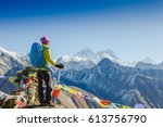 woman traveler with backpack... | Shutterstock . vector #613756790