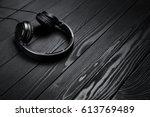 black headphones on black... | Shutterstock . vector #613769489