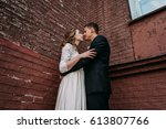 newlyweds embracing next to red ...   Shutterstock . vector #613807766