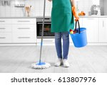 Woman Holding Mop And Bucket...