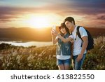traveling couple in love taking ... | Shutterstock . vector #613822550