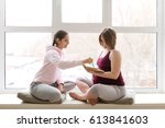 personal trainer giving advice... | Shutterstock . vector #613841603