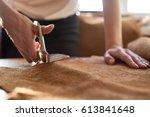 female artisan cutting brown...   Shutterstock . vector #613841648