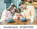 family with child in cafe | Shutterstock . vector #613847000