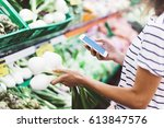 young woman shopping healthy... | Shutterstock . vector #613847576