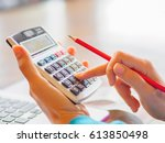 woman working with calculator ... | Shutterstock . vector #613850498