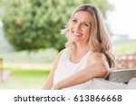 happy blonde mature woman... | Shutterstock . vector #613866668
