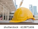 yellow safety hat is put on the ... | Shutterstock . vector #613871606