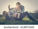 parents playing with their... | Shutterstock . vector #613871660