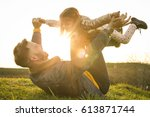 happy father playing and lying... | Shutterstock . vector #613871744