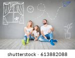 happy family sitting on wooden... | Shutterstock . vector #613882088