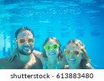 underwater portrait of family.... | Shutterstock . vector #613883480