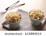 two bowls of brown rice on... | Shutterstock . vector #613884014