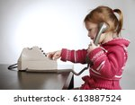 photo of little girl using old... | Shutterstock . vector #613887524